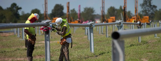 Solar workers on a solar farm construction site.