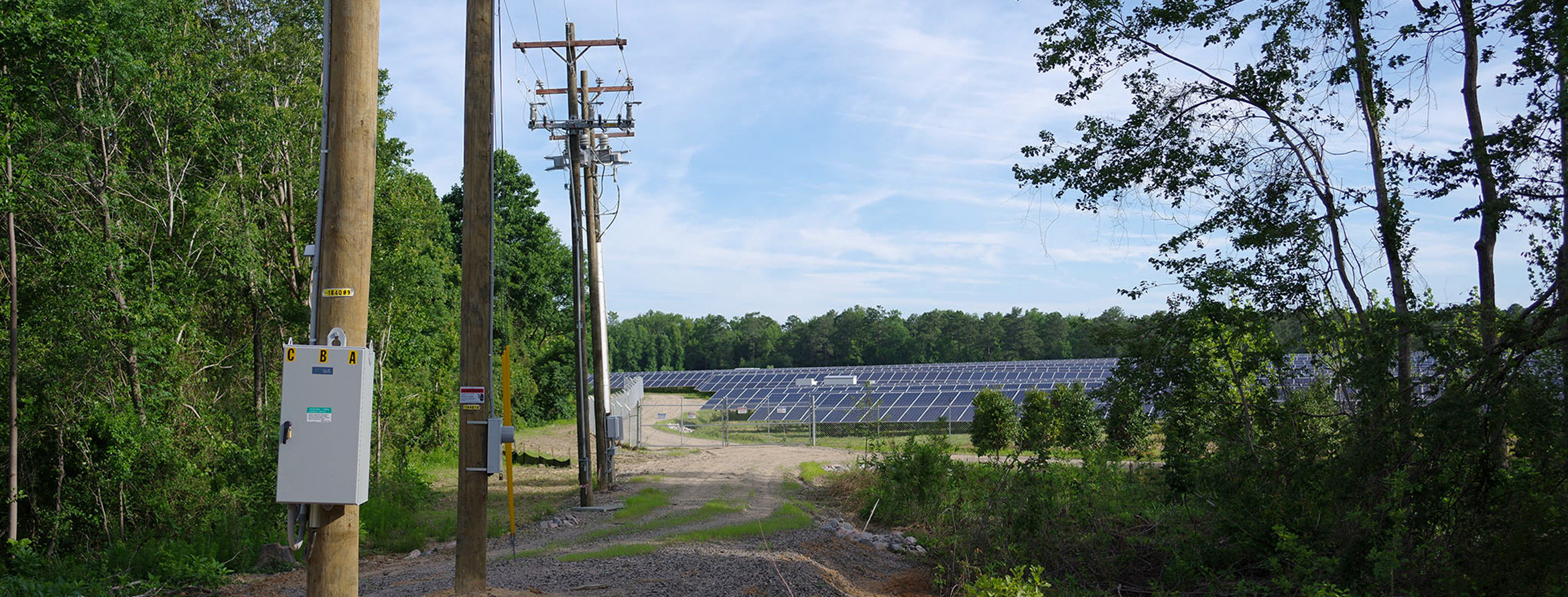 Power-Lines-And-Solar-Farm-In-Background.jpg